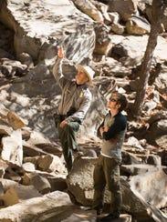 Chief Ranger Matt Hudson, left, discusses a climbing