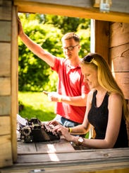 Guests to Grounds for Sculpture try out a typewriter