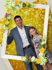 Sponsor A & G Pools's Travis Leonard with daughter
