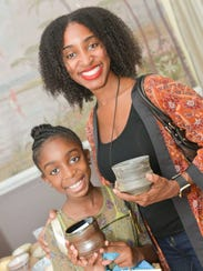 Kaitlyn and Naeemah Gary show off their bowl selections