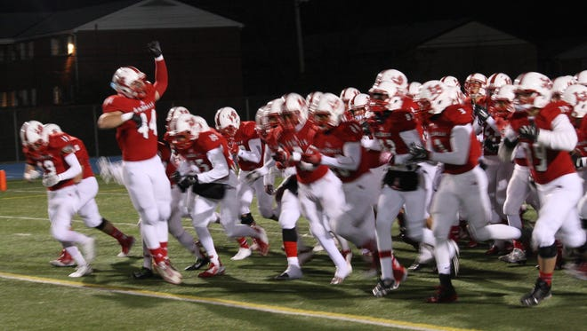 The La Salle Lancers take the field against Harrison.