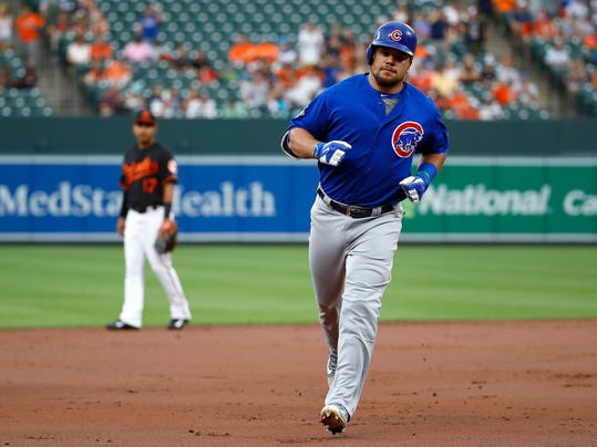 Chicago Cubs' Kyle Schwarber rounds the bases past Baltimore Orioles shortstop Ruben Tejada after hitting a solo home run in the first inning of an interleague baseball game in Baltimore, Friday, July 14, 2017. (AP Photo/Patrick Semansky)