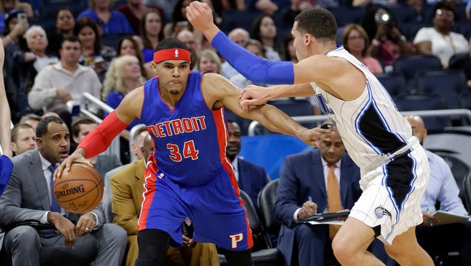 Tobias Harris drives against Magic forward Aaron Gordon during the first half of the Pistons' 115-87 loss Friday, March 24, 2017 in Orlando.