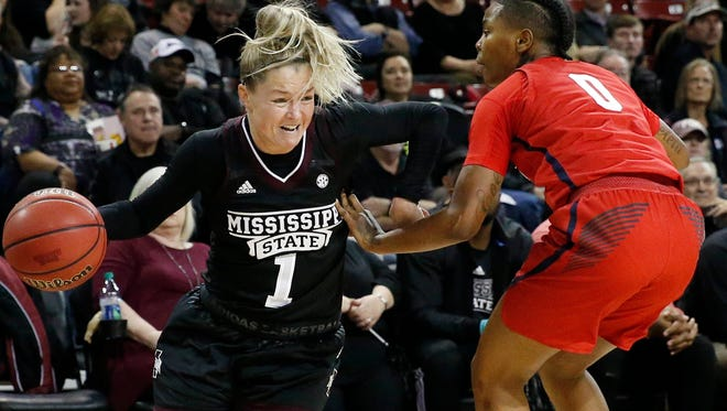 Mississippi State guard Blair Schaefer (1) is fouled by Ole Miss guard Chyna Nixon (0) during the first half of an NCAA college basketball game in Starkville.