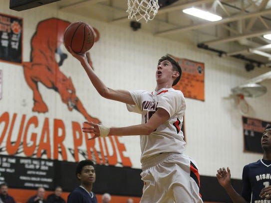Palmyra junior Isaac Blatt scores during the Cougars'