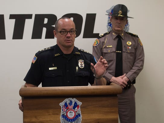 Pensacola Police Department Chief Tommi Lyter, left,
