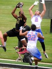 Abilene High's Qua'Shawn Washington intercepts a pass