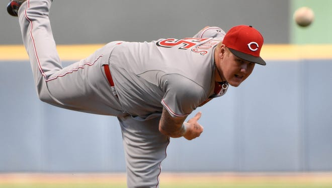 Mat Latos (55) pitches in the first inning.