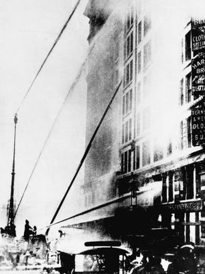 Firefighters work to put out the fire at the Triangle Shirtwaist Company in New York's Greenwich Village neighborhood on March 25, 1911.