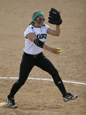 Mason starting pitcher Elle Buffenbarger delivers a pitch in the bottom of the fifth inning of the OHSAA D1 District Final softball game against Lakota East  on May 22. The Comets defeated the Thunderhawks, 8-7, in nine innings.