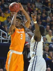 Tennessee's Robert Hubbs III hits a shot over ETSU's A.J. Merriweather during  Thursday's game at Freedom Hall in Johnson City.