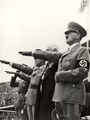 Adolf Hitler and his staff salute the teams during the opening ceremonies of the XI Olympic Games on August 1, 1936 in Berlin, Germany.