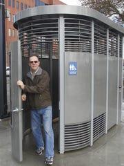 A man exits a Portland Loo in 2012 in Portland, Oregon.