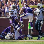 Sep 27, 2015; Minneapolis, MN, USA; San Diego Chargers quarterback Philip Rivers (17) is tackled by Minnesota Vikings defensive end Everson Griffen (97) and defensive tackle Sharrif Floyd (73) during the fourth quarter at TCF Bank Stadium. The Vikings defeated the Chargers 31-14. Mandatory Credit: Brace Hemmelgarn-USA TODAY Sports