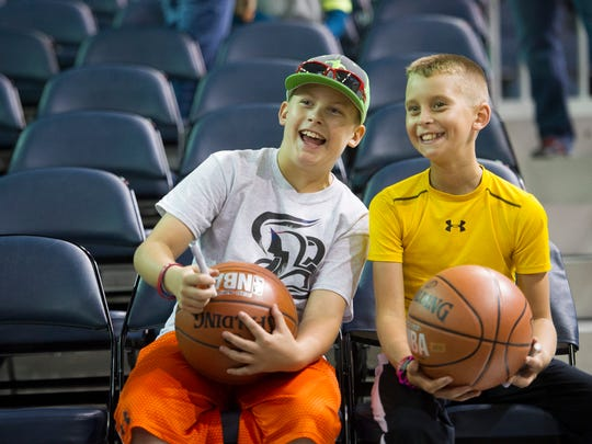 Casey Cates, 10, left, and Brady Belt, 9, both of Marion, Ky., share a laugh while looking for Pacers team members before a preseason game between the Indiana Pacers and the Milwaukee Bucks at the Ford Center in Evansville, Wednesday, Oct. 12, 2016.
