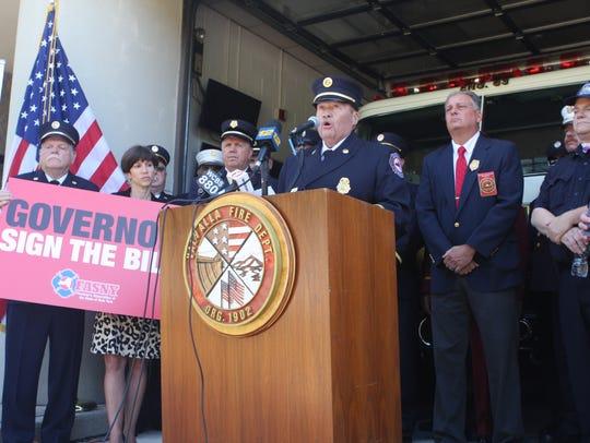 Brian McQueen, a former volunteer firefighter, speaks