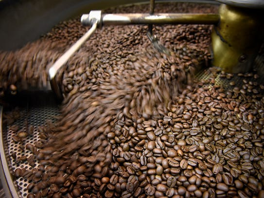 Coffee cools after being roasted Tuesday, Nov. 24,