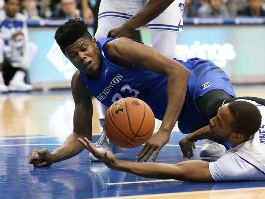 Madison Jones (in white) has contributed hustle plays like this one throughout the season for Seton Hall.