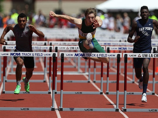 D.C. Everest's Konner Fierek, center, competes in the WIAA Division 1 110 meter hurdles at the state track and field meet Saturday at Veterans Memorial Stadium Complex in La Crosse. Fierek took first place in the event.