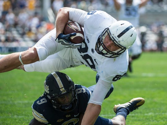 Penn State Nittany Lions tight end Mike Gesicki (88) is hit by Pittsburgh Panthers defensive back Jordan Whitehead (9) at  Heinz Field in Pittsburgh as Penn State fell to Pitt 42-39 on Saturday, Sept. 10, 2016.