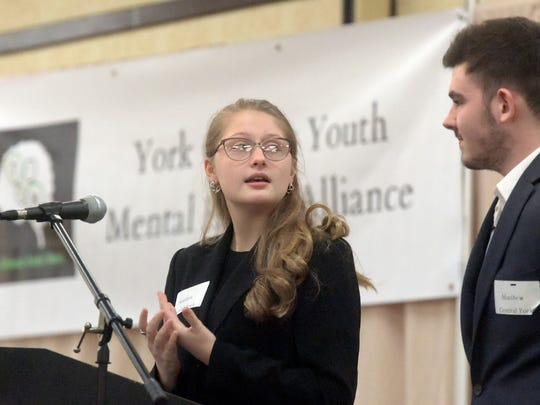 Central York High School sophomore Kaitlyn Arrow and senior Matthew Richard address the crowd during the York County Youth Mental Health Alliance at Wyndham Garden hotel Monday, Feb. 6, 2017. Students from York County districts questioned a panel of York County leaders during the town hall-style meeting. Bill Kalina photo
