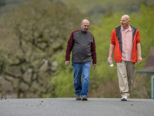 John Krahne, right, a lung cancer patient, and his