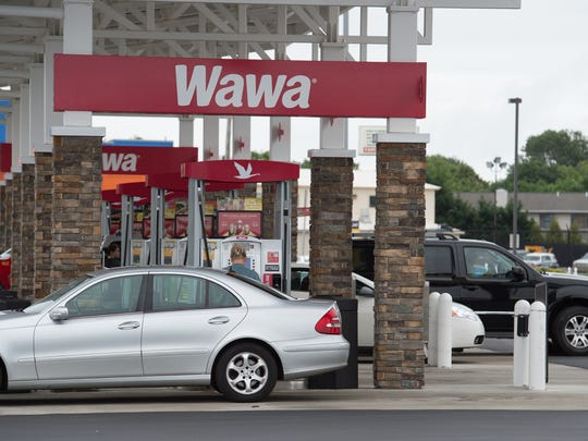 People filling up with fuel at Wawa in Rehoboth.