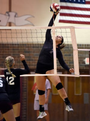 Henderson CountyÕs Libbie Dockemeyer spikes the ball over Webster CountyÕs Savana Mason during the first set of their game at Henderson County High School Monday.