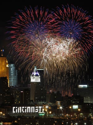 In this 2010 photo, Riverfest fireworks light up the sky over Cincinnati as seen from the Queens Tower in East Price Hill.