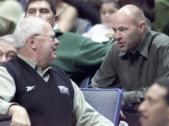 Ex-Michigan State basketball head coach Jud Heathcote, left, talks with ex-Spartan and Tigers star Kirk Gibson before an MSU game against Fresno State during their 2nd Round game in the NCAA tournament in Memphis, Tenn. on March 18, 2001.