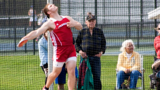 Coldwater High School senior Connor Covert throws the discus at Harper Creek High School on April 24.