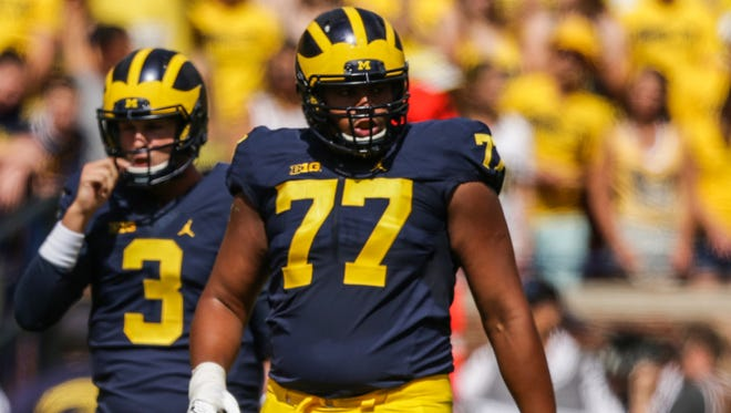 Michigan Wolverines left tackle Grant Newsome lines up against Hawaii during the 2016 opener at Michigan Stadium in Ann Arbor.