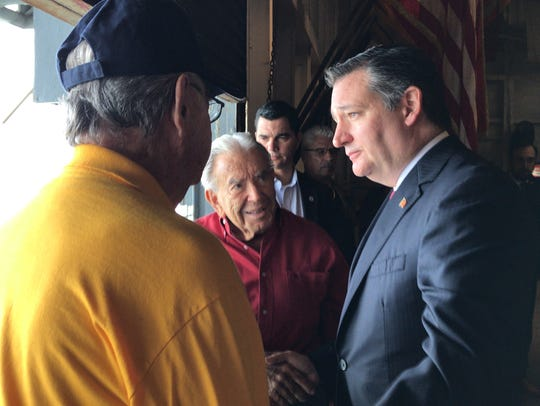 Senator Ted Cruz shakes hands with World War II veteran