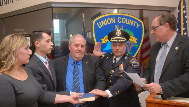 New Union County Police Chief James C. Debbie is sworn in. From left: Dawn Packan, Tyler Debbie, Jim Debbie, Police Chief James C. Debbie and Freeholder Chairman Bruce Bergen.