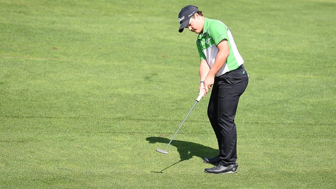 Fossil Ridge High School's Dillon Stewart putts in the last Front Range League golf match at Harmony Golf Club on Tuesday. Stewart took third overall individually this season in the FRL.