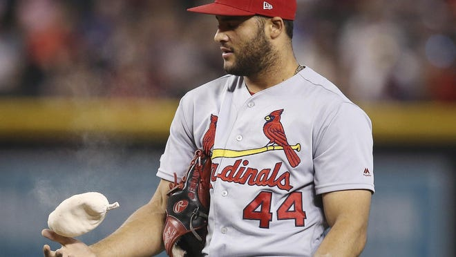 St. Louis Cardinals relief pitcher Junior Fernandez flips the rosin bag during the sixth inning of a game on Sept. 25, 2019 against the Arizona Diamondbacks in Phoenix. Pitchers will use their own personal rosin bags this season.