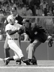 Detroit Tigers Manager Sparky Anderson is restrained by home plate umpire Jim Evans (right) in the bottom of the ninth inning as the California Angels outmuscle the Tigers, 4-2.