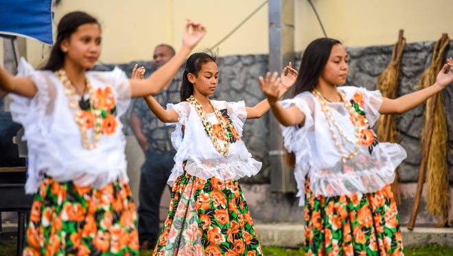 In this March 21 file photo, members of Oceanview Middle School's Guma' Nina'en Åcho' Latte student cultural group perform during a Mes Chamoru activity held at the security compound of Naval Base Guam in Sumay.