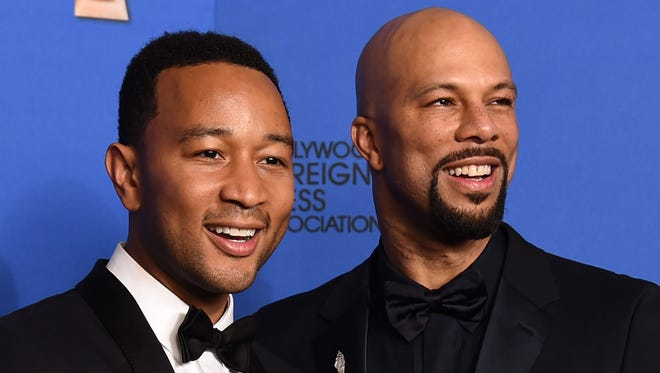 "John Legend, left, and Common pose in the press room after the award for best original song ""Glory"" in a film at the 72nd annual Golden Globe Awards in Beverly Hills, Calif."