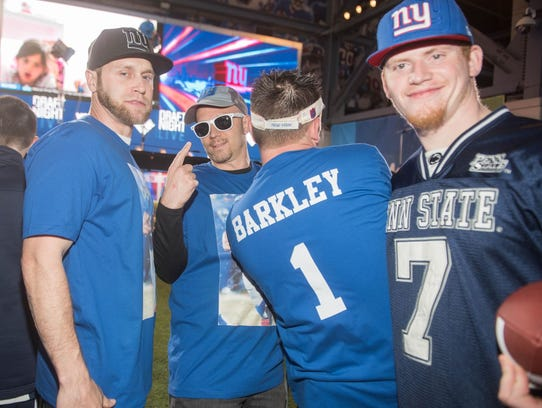 Giants fans sporting their Saquon Barkley gear. MetLife