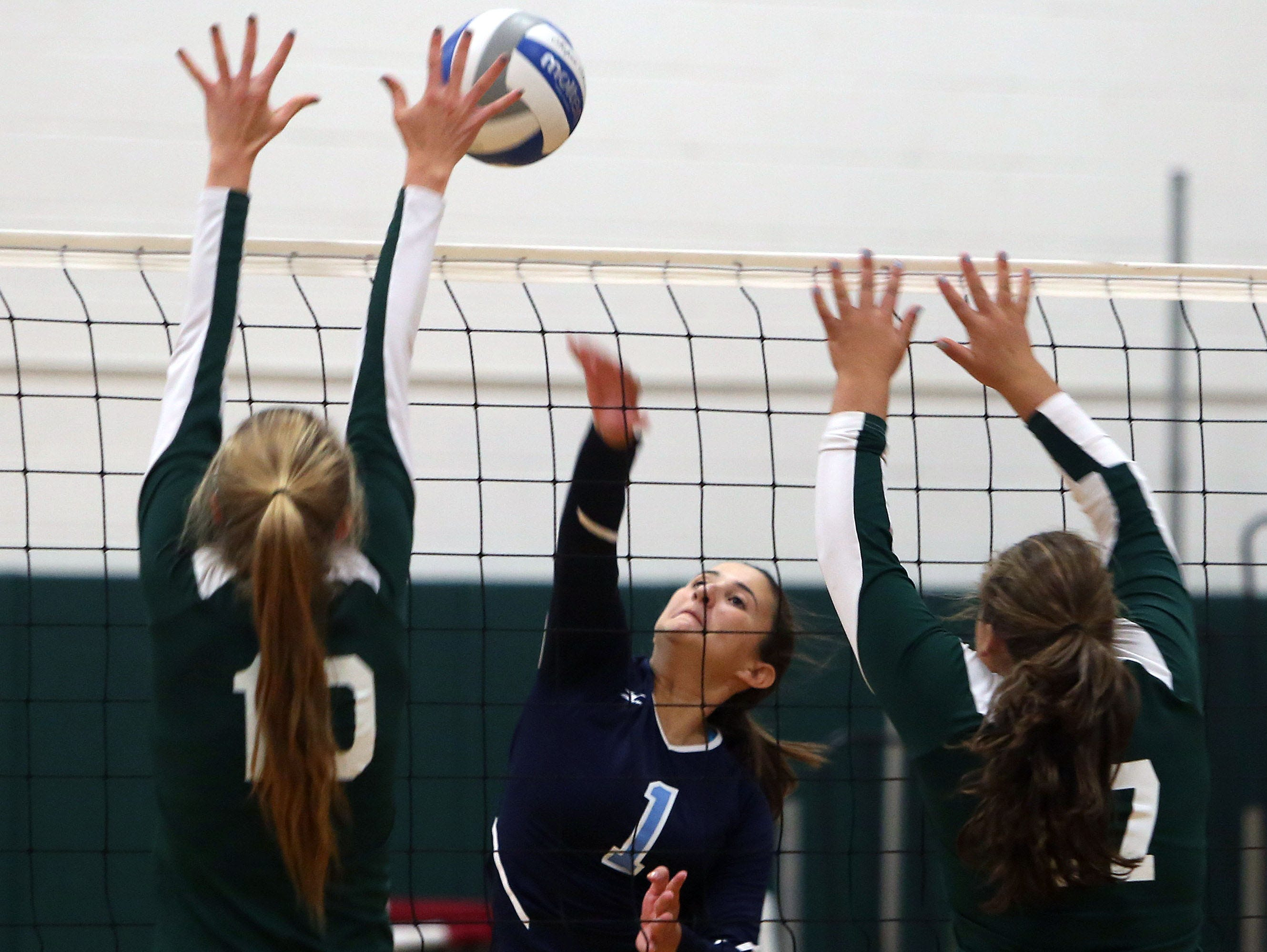Westlake's Angelina Guarnieri (1) gets a shot by Pleasantville's Annie Stockel (10) and Isabelle Minerva (17) during volleyball action at Pleasantville High School Sept. 30, 2015.