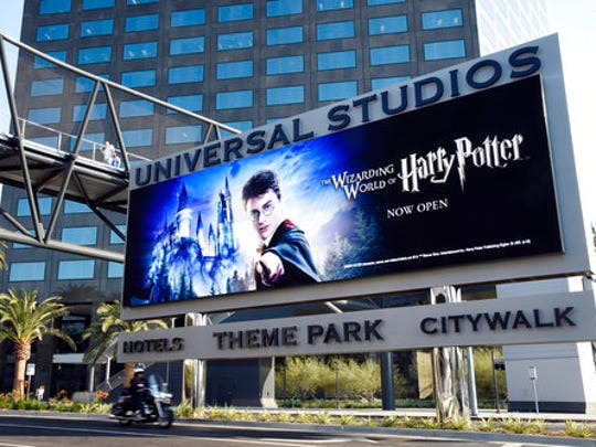FILE - In this Aug. 23, 2016 file photo, the entrance to Universal Studios is shown in Universal City, Calif. Since 2011, when Comcast first took over NBCUniversal's film and TV studios, cable and broadcast networks, TV stations and theme parks, the parks have been its biggest revenue driver.