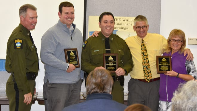 Three awards were presented at the Friends of the Chemung River Watershed's annual meeting Nov. 15. Pictured: John Burke, New York State Department of Environmental Conservation; Tony Burke, Vulcraft Inc.; John Lifrieri, DEC; Jim Pfiffer, Chemung River Friends; and Cynthia Huling-Hummel, River Friends Volunteer of the Year.