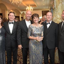 From left, David Brooks, president of St. Joseph Mercy Ann Arbor and Livingston hospitals; Laura Brooks; Debbie Snodgrass; and David Snodgrass, president and CEO of Lake Trust Credit Union, attend St. Joseph Mercy Livingston's Reaching for the Stars Ball. Lake Trust Credit Union was Presenting Sponsor for the 2016 ball and David Snodgrass served as ball chair.