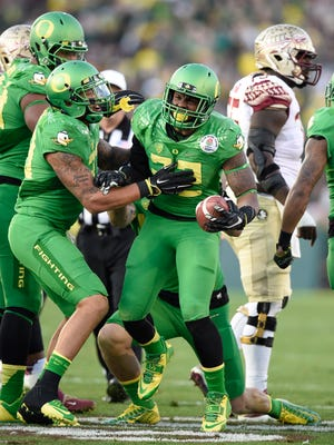 Oregon Ducks linebacker Derrick Malone (22) celebrates forcing a turnover against the Florida State Seminoles in the 2015 Rose Bowl college football game at Rose Bowl.