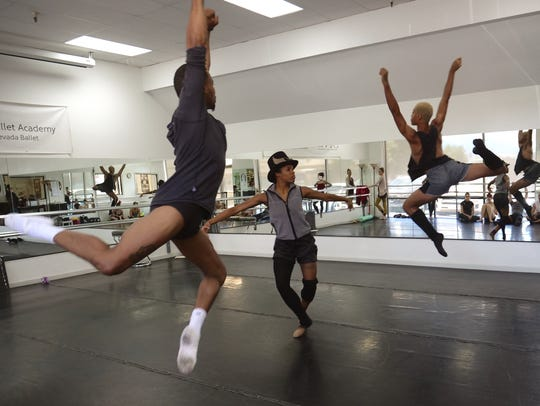 Darwin Black, Courtney Cochran and Amir Yorke rehearse