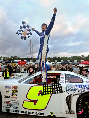 Chase Elliott celebrates after winning the 2013 Snowball Derby Sunday at Five Flags Speedway.