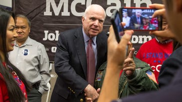 Sen. John McCain, R-Ariz., is photographed with supporters during a campaign rally on May 6, 2016, at his re-election headquarters in central Phoenix.