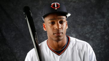 Brewers claim Twins OF Adam Walker, protect prospects