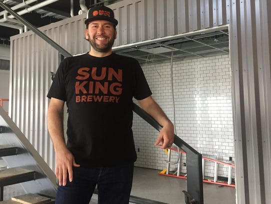 Sun King co-owner Clay Robinson stands in front of